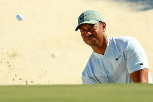 Tiger Woods plays a bunker shot on the third hole during the second round of the Hero World Challenge. Picture: Mike Ehrmann/Getty Images