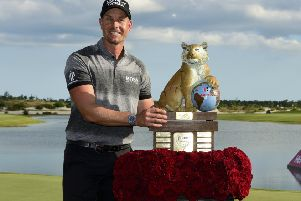 Sweden's Henrik Stenson poses with the trophy after winning the Hero World Challenge in Nassau. Picture: Dante Carrer/AP