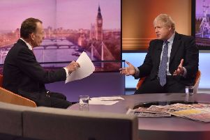 Prime Minister Boris Johnson speaks with political journalist Andrew Marr.  Photo: JEFF OVERS/ AFP