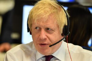 Boris Johnson speaks to a caller as he mans the phones at the Conservative Campaign Headquarters Call Centre. Picture: WPA Pool/Getty Images