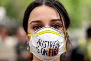 A demonstrator makes a point at a climate protest rally in Sydney on Wednesday as bushfire smoke chokes the city, causing health problems to spike. (Picture: Saeed Khan/AFP via Getty Images)