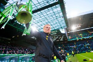 Neil Lennon parades the Betfred Cup ahead of the match with Hibs
