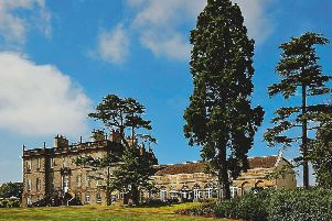 The grand country house exterior of DalmahoyHotel and Country Club, Kirknewton