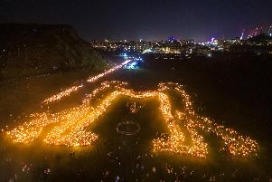 Thousands of torch-bearers formed a 'friendship' symbol in Holyrood Park at the finale of the torchlight procession.