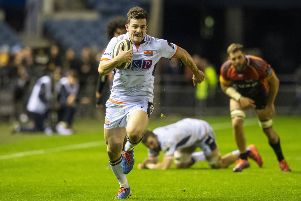 Matt Scott breaks away to score Edinburgh's third of nine tries in the thumping victory over Southern Kings. Picture: Ross Parker/SNS/SRU