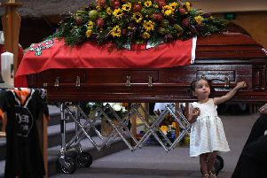 Charlotte O'Dwyer, the youngest daughter of Rural Fire Service volunteer Andrew O'Dwyer stands in front of her father's casket. Picture: GettyImages