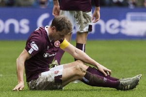 Christophe Berra cuts a forlorn figure after Hearts' defeat by Hibs on Boxing Day.