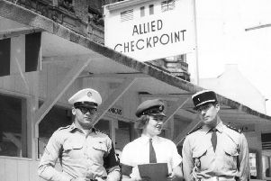26th August 1965:  British corporal Phyllis Luke with her American and French colleagues on duty at the Checkpoint Charlie border point in Berlin.  (Photo by Keystone/Getty Images)