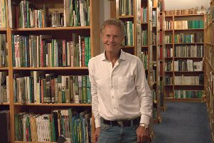 Alastair Johnson with his collection of books, which he is donating to the R&A in St Andrews