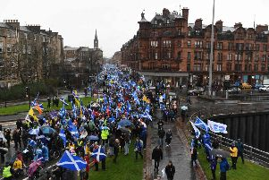 Pro-independence marchers file past the M8 motorway at Charing Cross in Glasgow on Saturday. Organisers claimed around 80,000 people took part. Picture: AFP