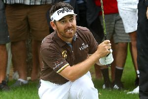 Louis Oosthuizen of South Africa plays his second shot into the 16th green. Picture: Warren Little/Getty Images
