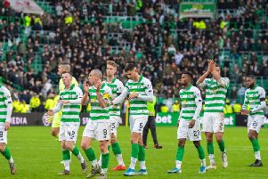 The Celtic players applaud the fans at the end of the Old Firm clash in December