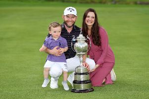 Branden Grace shows off the trophy along with his wife Nieke and their son, Roger. Picture: Getty.