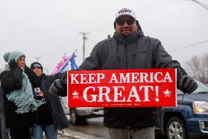 "A Trump supporter holds a sign that reads ""Keep America Great"", a reference to the US President's election campaign slogan ""Make America Great Again"" during a rally in Joliet, Illinois. (Picture: Joshua Lott/AFP via Getty Images)"