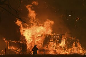 The Gospers Mountain Fire rips through a building in Bilpin, New South Wales, last month (Picture: Dan Himbrechts/AAP Images via AP)