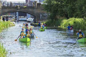 Primary school pupils go for a paddle on the Union Canal, an idyllic waterway that runs from Edinburgh to Falkirk (Picture: Malcolm McCurrach)