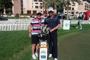 David Drysdale, pictured with his wife and caddie Vicky, opened with a two-under-par 70 in the Abu Dhabi HSBC Championship