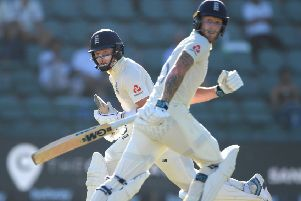 England batsmen Ollie Pope, left, and Ben Stokes pick up runs om day one of the Third Test against South Africa at St George's Park. Picture: Stu Forster/Getty