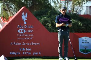 Grant Forrest checks his yardage book during the second round of the Abu Dhabi HSBC Championship