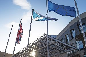The Scottish Saltire, the Union Jack and the flag of the European Union fly outside the Scottish Parliament (Picture: Neil Hanna)