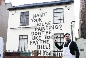 Painter and decorator, Dean Reeves took revenge by painting the message on the side of the pub. Picture: SWNS