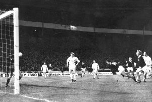 Joe Jordan heads home against Czechoslovakia, the goal which took Scotland to the 1974 World Cup. Picture: Getty Images