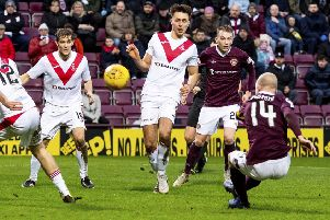 Steven Naismith, playing his first game as Hearts' new captain, hooks home the third goal against Airdrie. Picture: Alan Rennie/SNS