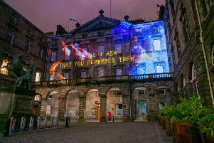 Kayus Bankole's words projected onto Edinburgh City Chambers as part of Message From the Skies PIC: Rianne White