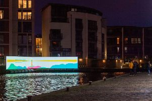 Kathleen Jamie's words are projected beside the Union Canal, Fountainbridge as part of Message From the Skies