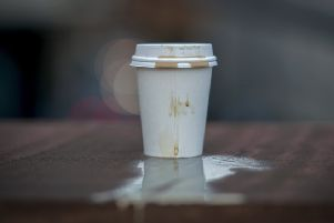 MANCHESTER, ENGLAND - JANUARY 05: In this photo illustration a disposable coffee cup sits on a wall on January 05, 2018 in Manchester, England. Some members of the UK Parliament are calling for a 25p levy on all disposable coffee cups to drive consumers to the re-usable variety and to fund the costs of recycling. (Photo illustration by Christopher Furlong/Getty Images)