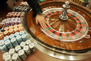 The rise of internet gambling means people no longer need to visit casinos or betting shops (Picture: Kin Cheung/AP)