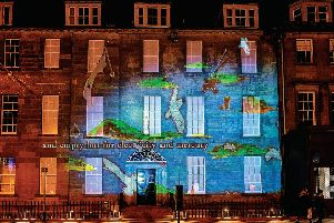 Charlotte Runcie's Message From The Skies text projected onto the Northern Lighthouse Board building on George Street