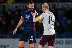 Steven Naismith has words with Ross County's Keith Watson during the match at Dingwall. Picture: SNS