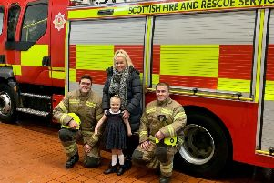 Hollie and her mum Siobhan Mullen were invited to meet local fire fighters to celebrate her bravery.