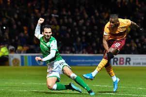 Motherwell's Christy Manzinga see's his effort rattle off the crossbar