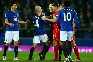 Liverpool pair Steven Gerrard and Jordan Henderson clash with Steven Naismith of Everton during a Premier League match at Goodison Park in February 2015.