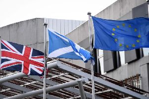 The Union Flag, Saltire and EU flag fly over Holyrood. Picture: Andy Buchanan