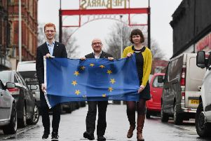 From left, Scottish Greens members Ross Greer, Patrick Harvie and Cass MacGregor display a European flag at the Barras market in Glasgow on the day the UK officially leaves the EU. Picture: John Devlin