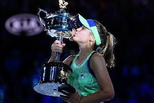Sofia Kenin kisses the Daphne Akhurst Memorial Cup after beating Spain's Garbine Muguruza to win the Australian Open. Picture: Saeed Khan / AFP