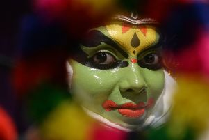 An artist prepares for a performance of Kathakali, a classical dance created in Kerala's ancient kingdoms (Picture: Arun Sankar/AFP/Getty Images)
