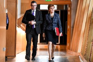 Derek Mackay with Nicola Sturgeon, who has been challenged over the speed of her response to damaging revelations. Picture: Jeff J Mitchell/Getty