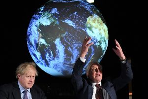 Boris Johnson sits with Sir David Attenborough during the launch of the Cop26 UN Climate Summit, which will take place this autumn in Glasgow (Picture: Chris J Ratcliffe-WPA Pool/Getty Images)
