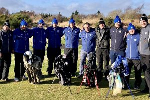 The seven ex-servicemen taking part in the Caddie School for Soldiers in Fife with their tutors.