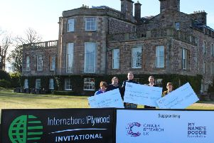 Doddie Weir and representatives of the two other charities receive their cheques from Ian Attwood, managing director of International Plywood, and Tom Younger, chief executive of Archerfield Links, at Archerfield House.