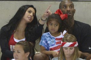 Kobe Bryant with his wife Vanessa and daughter Gianna pictured in 2012 (Picture: Mark J. Terrill/AP)