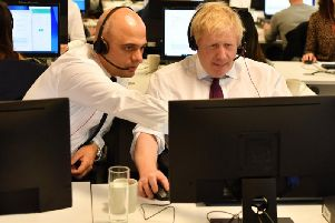 Former Chancellor Sajid Javid and Prime Minister Boris Johnson during the election campaign