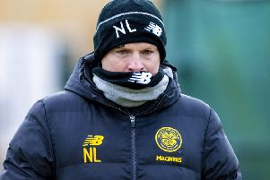 The morning after his side moved ten points clear in the title race, Neil Lennon was back on the training pitch preparing for Celtic's trip to Aberdeen. Picture: Craig Williamson/SNS