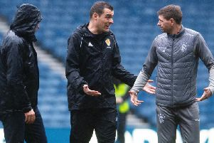 Rangers boss Steven Gerrard exchanges words with referee Don Robertson as officials and groundstaff inspect the Ibrox pitch