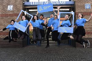Pupils from Leith Academy unveil the new branding for the school's partnership with the Edinburgh International Festival. Picture: Lisa Ferguson.