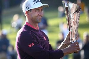 Adam Scott shows off the trophy after his two-shot win in the Genesis Invitational hosted by Tiger Woods in Los Angeles